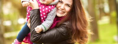 people_happy_mother_with_a_baby_in_her_arms_097914_